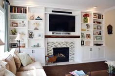 Declutter bookshelves - often packed with twice the stuff they should hold. Mix horizontal stacks of books among the vertical rows and intersperse decorative objects like bowls or vases among them. Built In Around Fireplace, Fireplace Built Ins, Bookshelves Built In, Fireplace Remodel, Bookcases, Bookshelf Wall, Modern Fireplace, Fireplace Wall, My Living Room