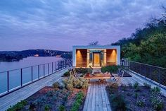 Modern home design Cliff dwelling Lake Austin view rooftop garden house entry