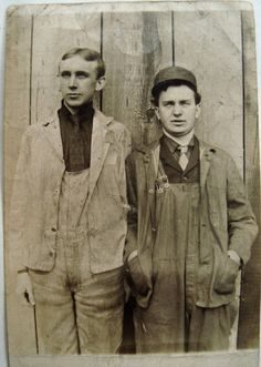 layering: collar, tie, vest, overalls, coat lapels, and a hat...framed to the gills  Edwardian era workers