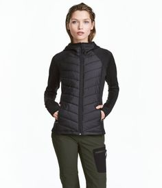 Black. Outdoor jacket in functional fabric with lightly padded front and back sections in woven fabric. Lined hood, zip at front, side pockets with zip, and
