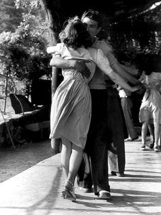 a man and a woman dancing in a close embrace, 1947. © vincenzo balocchi/ alinari.