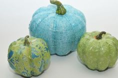 Mod podge paper onto pumpkins