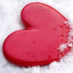 Red heart in the snow