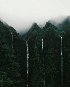 Magical Hawaiian waterfalls during the rain off of the highway H3. Oahu is such a beautiful place.