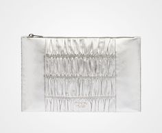 Silver Orada ruched clutch. Gaufré nappa leather clutch Steel hardware Metal lettering logo Zipper closure Two inside pockets, including one with zipper closure Nappa leather lining