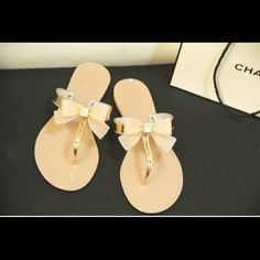 Flip flop with bow Black or ivory sandals with rhinestones on bow. Brand new. No half sizes so if your a half you will go up to the next size up. Comfortable. I have them in black and ivory from sizes 7 to 10. Let me know color and size Shoes