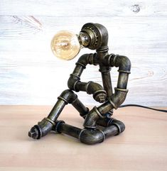 Items similar to Sitting robot table lamp / industrial pipe lamp / robot-thinker table lamp / sitting man desk lamp / steampunk table lamp / pipe man lamp on Etsy Steampunk Desk, Steampunk Furniture, Luminaria Diy, Pipe Decor, Metal Art Projects, Pipe Furniture, Furniture Vintage, Industrial Furniture, Industrial Pipe