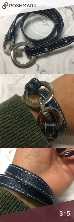 Lia Sophia leather wrap bracelet in navy blue 😍 Lia Sophia leather wrap bracelet in navy blue with silver details and white stitching. My wrist measures 6inches this bracelet comfortably wraps around twice . Bracelet measures a total of 16.5 inches . Only wore once In great condition. Lia Sophia Jewelry Bracelets