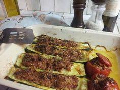 Recette de Courgettes et tomates farcies au parmesan et à la chair à saucisse