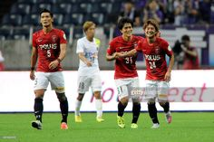 Takahiro Sekine (R) of Urawa Red Diamonds celebrates scoring his team's first goal with his team mate Toshiyuki Takagi (C) during the J.League match between Urawa Red Diamonds and Sanfrecce Hiroshima at Saitama Stadium on July 19, 2015 in Saitama, Japan.