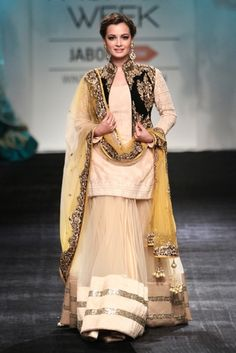 Diya Mirza in a Lehenga by Vikram Phadnis. To view more, visit: http://www.vogue.in/content/baraatis-guide-wedding-wear#1