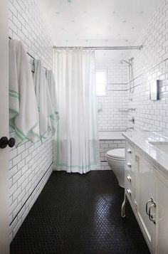 antique reproduction hex tile floor This Coconut Grove bathroom