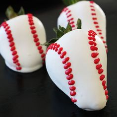 Home Run Chocolate Covered Strawberries: After dipping the strawberries in white chocolate, two thin lines of white chocolate were piped on each strawberry. Red candy melts were melted and used to pipe the stitching marks.