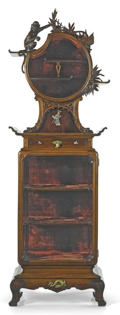 French Japonism VITRINE CABINET, CIRCA 1880 mahogany, stained fruitwood, engraved bone and mother of pearl, bronze marked LM (83 ½ x 27 ¼ x 16 ½ in.)
