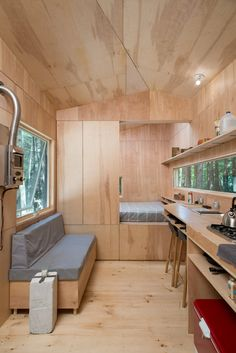 Designers crafted the Lorraine as a writers retreat, with a continuous work surface that stretches from the kitchen to the bedroom. Tiny Houses For Rent, Tiny House On Wheels, Tiny House Cabin, Tiny House Living, Cabin Design, Tiny House Design, Plywood Interior, Casas Containers, Tiny Spaces