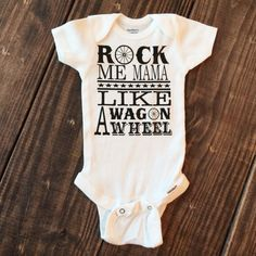 Rock Me MamaOnesie Available in White. Available in Short Sleeve and Long Sleeve. Made of 100% cotton 1x1 rib for extra give in the belly area Lap-shoulder nec