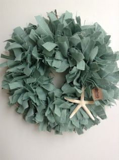 A personal favorite from my Etsy shop https://www.etsy.com/listing/161464886/beach-wreath-starfish-wreath-blue-wreath