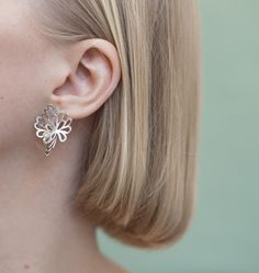 Intricate and decorative design brings lightness to these summery silver flowers. Collection draws its inspiration from aquatic plants with floating, lovely flo Sterling Silver Earrings Studs, Stud Earrings, Lovisa Jewellery, Silver Flowers, Contemporary Jewellery, Modern Luxury, Precious Metals, Jewelry Design, Jewels