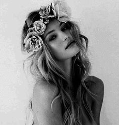 Long hair with floral headband.