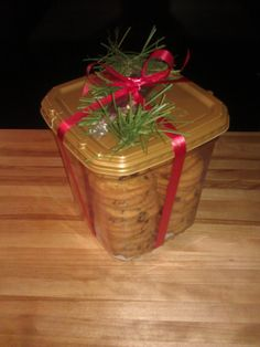 Great use for the empty Biscotti container.  Fill it with your own homemade cookies, tie w/ribbon & add some holiday decoration.
