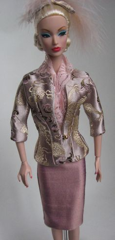 Integrity's Victoire models gold/pink silk suit with dragons!