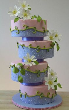 4 Tier Cake decorated with gumpaste / http://www.petalcrafts.com/cake-inspirations.html
