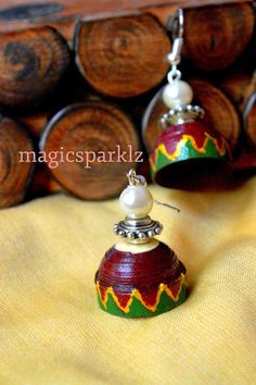 quilled maroon and green jhumka with ethnic touch