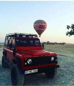 Land Rover Defender 110 Td4 Sw Se customized TWISTED in red.