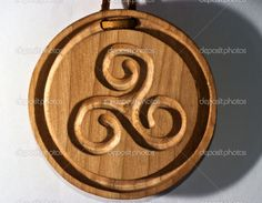 celtic wood carving | Medallion of wood carving of Celtic origin with triskell | Stock Photo ...