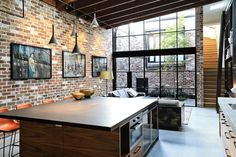 Open and industrial living space with brick walls Old Garage with Heritage Façade Finds New Life as a Fabulous Family Home