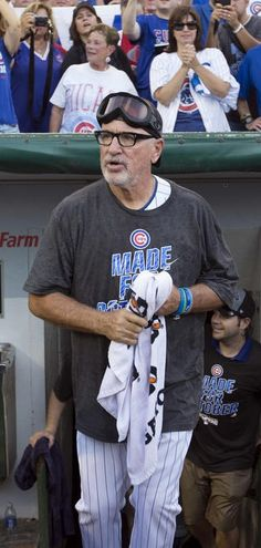 Joe Maddon emerges from the dugout as the Cubs celebrate their National League Central title Friday, Sept. 16, 2016, at Wrigley Field. Brian Cassella / Chicago Tribune