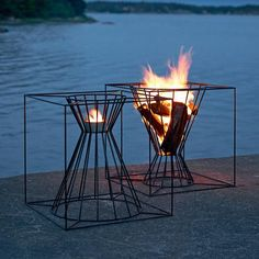 Gather Around These 7 Modern Fire Pit Designs - Photo 2 of 7 - The Boo Fire Basket from Skargaarden is made of black lacquered steel. Designed to fit several logs for an outdoor fire, the Boo can also be overturned to hold a candle or lantern. Outdoor Fire, Outdoor Living, Outdoor Spaces, Parrilla Exterior, Fire Basket, Freestanding Fireplace, Fire Pit Designs, Fire Pit Backyard, Fireplace Design