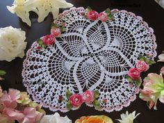 This new crochet doily is handmade and measures approximately 20x17 includes decorative pretty flowers. This item is handmade by me using cotton