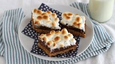 Blogger Stephanie Wise of  Girl versus Dough bakes up s'mores in bar form with gooey marshmallows, a fudgy center and a graham cookie crust.