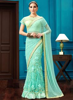Shop saree online. Buy this flattering turquoise classic designer saree for bridal and wedding. Shop now! Customization & worldwide free shipping.