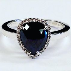 Beautiful black diamond engagement ring for the bride with an edge! Find all of your heart's diamond desires at Coby Madison Jewelers #blackdiamondengagementrings  #blackdiamondrings