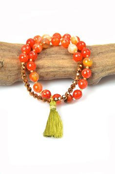 JeanneVerger.com - Orange Agate is believed to evoke courage and spiritual fortitude, to reduce fear and to encourage feelings of security and safety. Orage Agate will bring you spiritual grounding.  Available here: http://shop.jeanneverger.com/collections/bling-bling-wrist-mala/products/fire-agate-wrist-mala