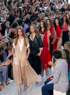 Chloe. 'There's something flying about a Chloé girl. She's always moving, never still.' So says creative director Clare Waight Keller, who referenced Anne-France Dautheville, the first woman to ride a motorbike around the world solo in the 1970s in a chic wardrobe of leather overalls, zipper boots and billowing dresses, as her muse for this collection. SS17 Runway.
