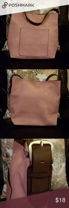 Large tote A perfect blush pink, leather tote. The interior is a soft, brown, sueded leather. The outside has a large pocket, and the bag closes with a strong magnetic snap. Straps, as shown,  are adjustable. Like new! Bags Totes