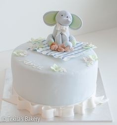 elephant cake for baby boy with fondant baby, flowers and bowl www.tekila.fi