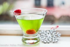 Elf Coctail   1 oz midori    2 oz citrus vodka    1 oz white cranberry juice   cherries for garnish     In a shaker, add ice and all of the ingredients above except for the cherries.  Shake and strain into a martini glass.  Garnish with cherries