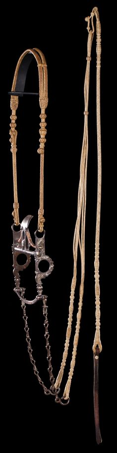 Luis B. Ortega Split-Ear Headstall extra impressive, all natural flat braided rawhide split ear headstall. Made with 3 strands that are whip stitched together with great knots and all in unused condition. Also included, a silver inlaid CA spade bit with thing engraved lip bar and old chains. Brian Lebel's Mesa Auction - January 21, 2017 Sold $5,310 Western Tack, Western Riding, Horse Riding, Horse Gear, Horse Tack, Lip Bars, Cowboy Gear, Horse Shirt, Horse Jewelry