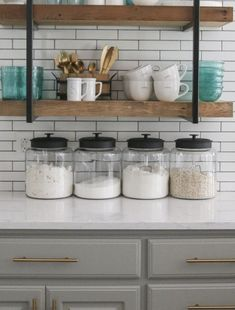 These are one of my favorite things I added to my kitchen. They are large montana jars with airtight black lids. They are perfect for storing dry stuff you use often. The are super inexpensive too!