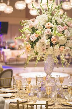 Lush Centerpiece with Pastel Florals | Photography: Chip Gillespie. Read More: http://www.insideweddings.com/weddings/classic-jewish-wedding-at-a-synagogue-in-houston-texas/718/