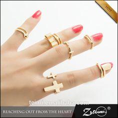 4e5973c50adb Sleek Metallic Bow Heart Nail Cross Smooth Golden Rings for Women Fashion  Ring 7 pcs set