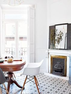 great mix of modern, traditional and pattern in this white, open dining room