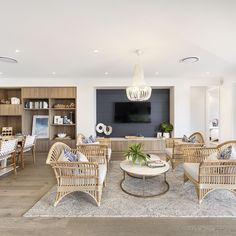 The Miami 16 at South Nowra is beautifully styled as a coastal oasis, applicable no matter how close your house is to the coastline.  Seafoam whites, light wood and cane furniture accented by blue furnishing and features.