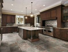 Google Image Result for http://www.kitchencabinetscolors.com/wp-content/uploads/2012/05/New-Kitchen-Flooring-Ideas-Dark-Wood-550x418.jpg
