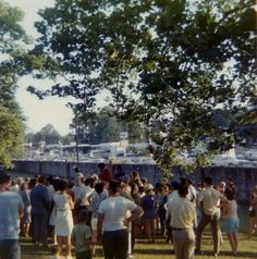 June 6,1969 on the grounds of  Graceland. Elvis on horseback signing autographs and taking photos