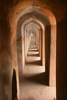 Geometric Progression - Lucknow, Uttar Pradesh. The picture was shot in a manmade labyrinth called Bhool Bhoolaiya in Lucknow, India where there are a large number of corridors like this. One may easily get lost in this maze without a guide. A grand view of the city awaits the visitor when he reaches the roof. Only the Nawab who built it and a few others knew the right way in this intricate labyrinth.